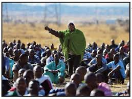 South Africa's Top Story of the Year. The man in the green blanket was killed along with 33 other man on the 16 of August 2012. A massacre that has changed the face of SA forever.