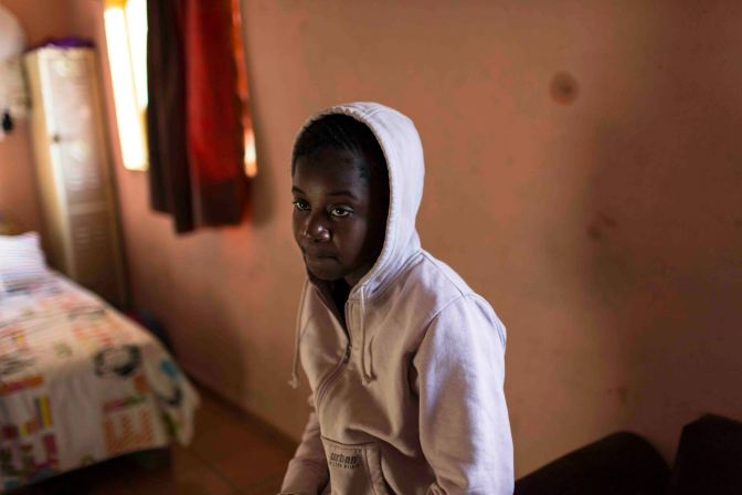 Lerato: A teenage girl in the room she shares with other orphaned girls at SKY (Soweto Kliptown Youth)in Kliptown, Soweto, Johannesburg, South Africa. Pic: Julia Seister