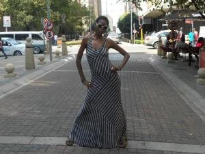 On  another day (one of my favourite dresses) Glasses: Mr Price  Price: R30 Dress: Big Blue Price: R500 Ring Silver: Prine of Newtown Price: R50 rand Yellow Ring: Jenna Leigh des Fontein Prices: Less Model: Jedi Ramalapa Loation: Mainstreet, Marsharll Town Johannesburg. Picture: Tshepo Ramalapa