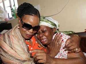 National Freedom Party Leader; Zanele KaMagwaza Msibi, comforting a grieving mother. KwaMashu 2014